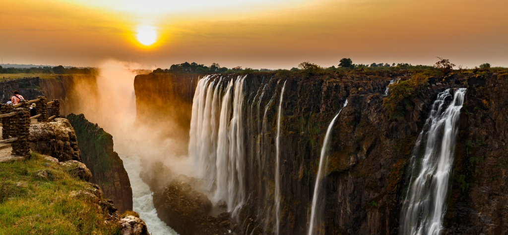Wide panorama image of Victoria Falls in Zambia at sunset